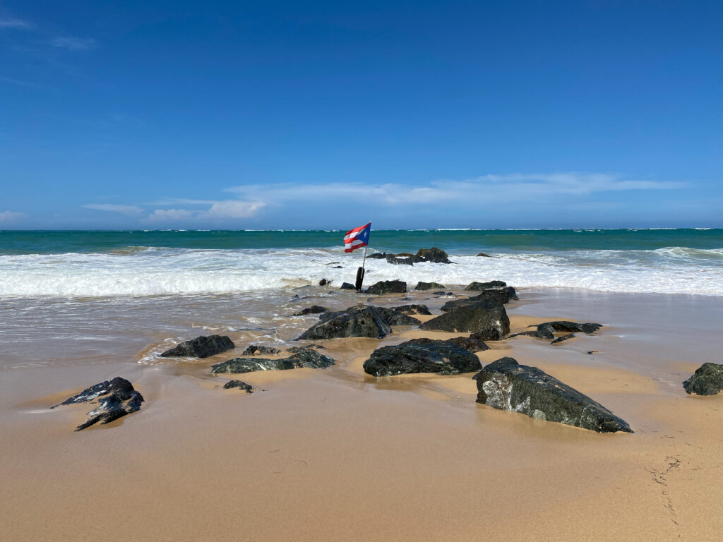 Puerto Rican flag on the beach in Condado